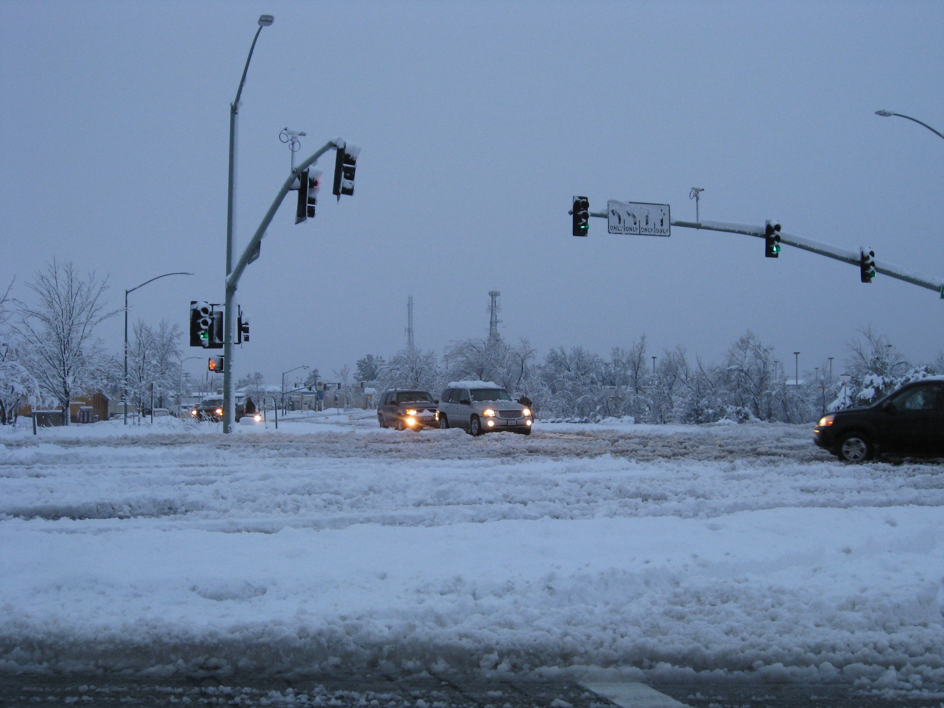 Snow at Lake Boulevard and Market Street intersection stopped most traffic, with some cars caught in snow.