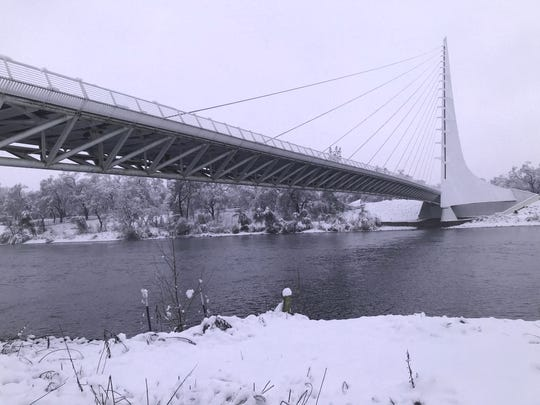 Snow paints a winter scene in February 2019 at the Sundial Bridge in Redding.