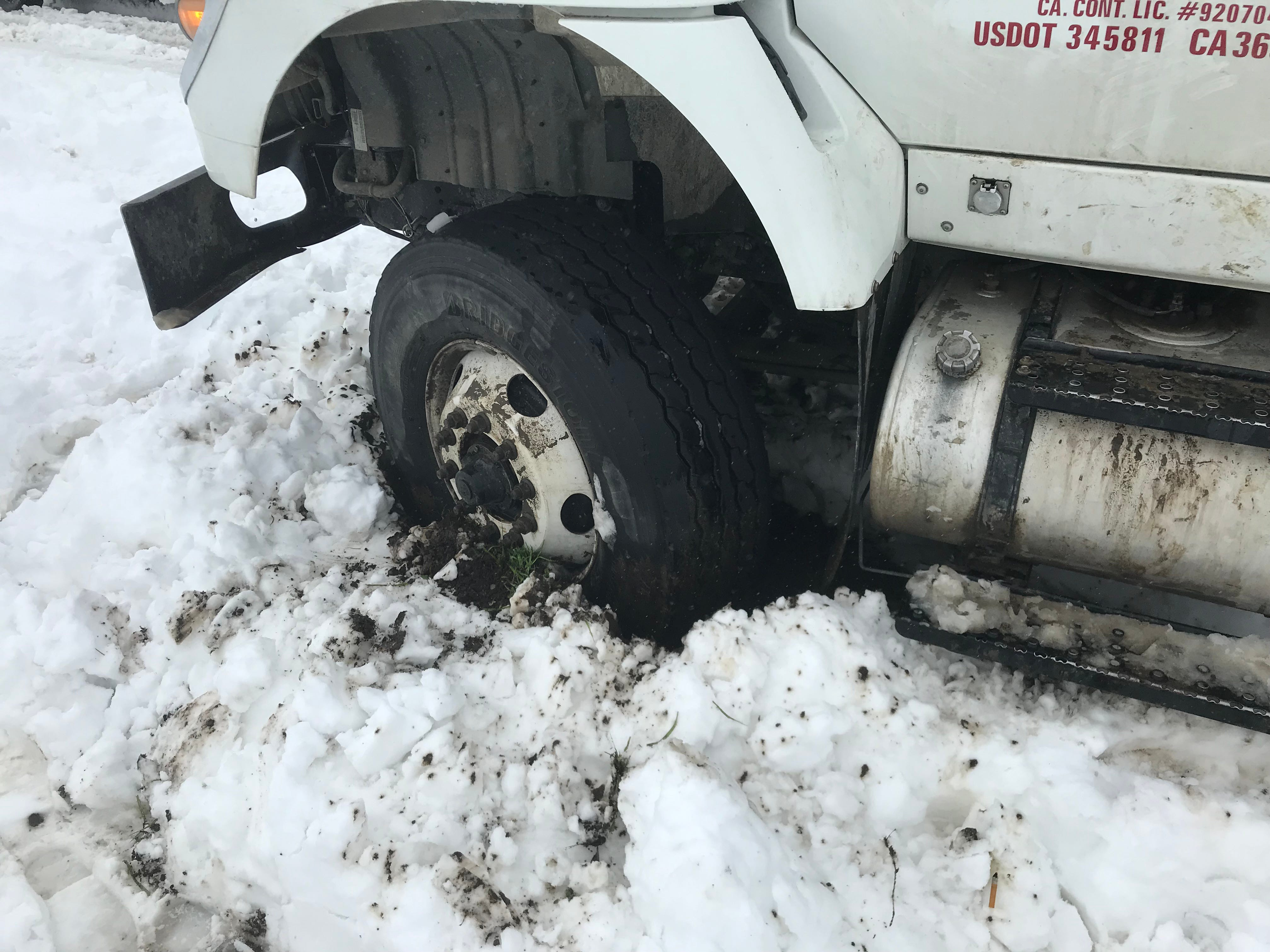 A truck got stuck in the snow along Interstate 5 in Anderson on Wednesday.