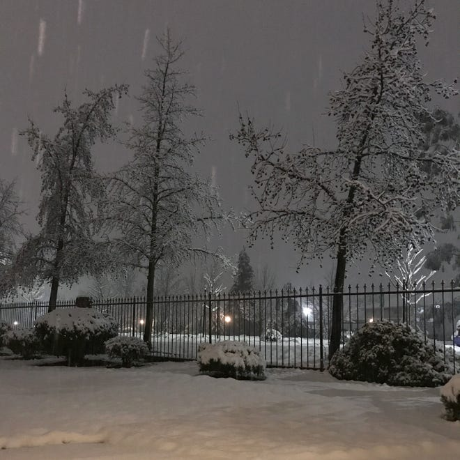 Snow falls on Wednesday, Feb. 13, 2019 in north Redding.