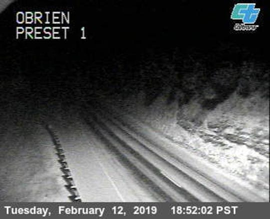 Snow is seen near O'Brien north of Redding in this February 12, 2019 shot from the California Department of Transportation's road camera along Interstate 5.