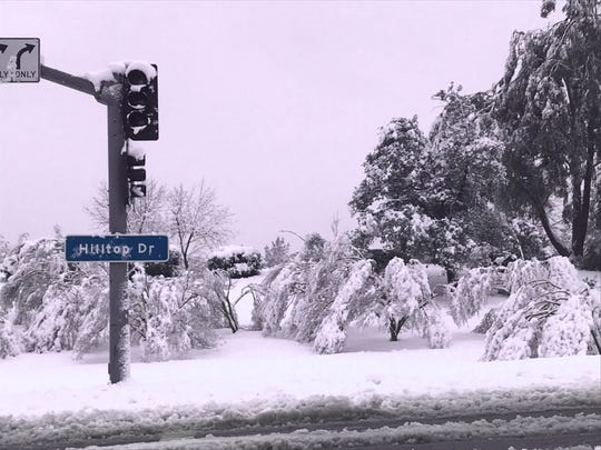 Power outages Wednesday morning caused numerous stoplights to go out in Redding due to the overnight snowstorm.