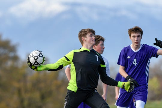 Shasta High goalkeeper Chase Sherman throws the ball to a teammate in a 2-0 win against Lassen on Nov. 30, 2018.