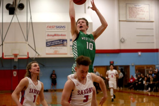 West Salem's Justin Scoggin (10) goes up in the paint during the South Salem vs. West Salem boys basketball game at South Salem High School on Tuesday, Feb. 12, 2019.
