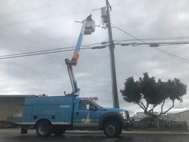 FILE: Pacific Gas and Electric crews respond to a power outage Tuesday.