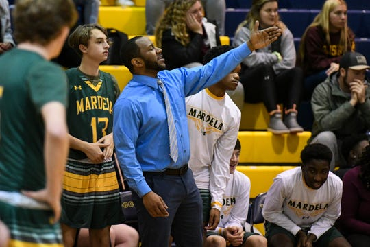 Mardela basketball coach Jermichael Mitchell leads his team in a game at Pocomoke High School on Tuesday, Feb. 12, 2019.
