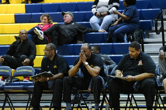 Pocomoke High School head coach Derrick Fooks (center) leads the team in a game against Mardela High on Tuesday, Feb. 12, 2018.