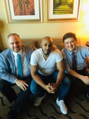 """Michael """"Mystikal"""" Tyler with his attorneys Joel Pearce, left, and Timothy Yazbeck, right, following the rapper's release from Caddo Correctional Center Feb. 13."""