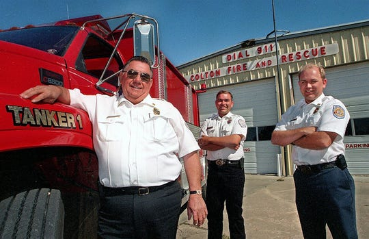 LeRoy Koopman (left) of the Colton Fire Department is pictured with sons Monte (center) and Michael (right) in 1999. LeRoy is retiring as Colton fire chief later this month.