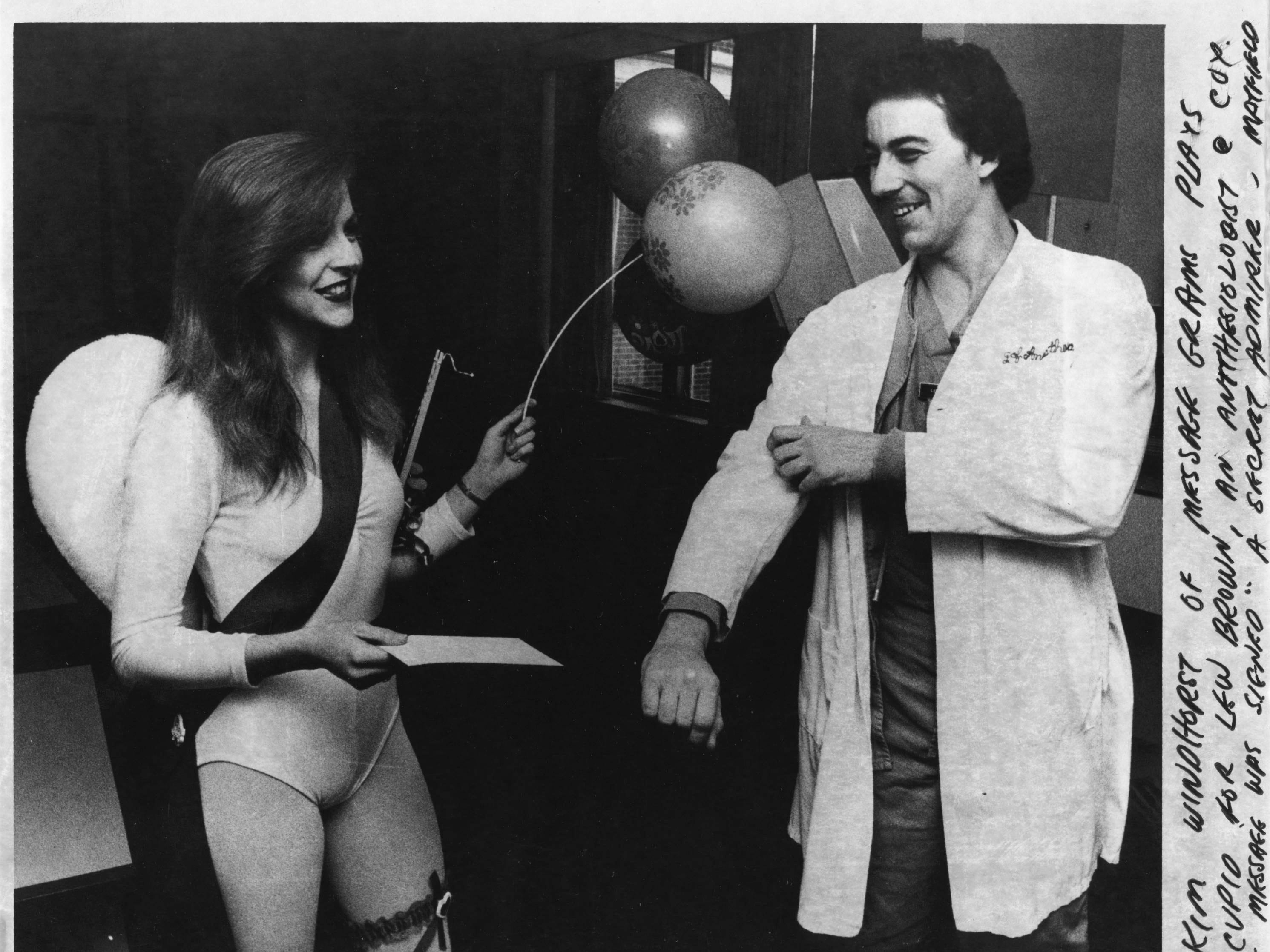 "Kim Windhorst of Message Grams plays cupid for Lew Brown, an anesthesiologist at Cox in 1982. The message was signed ""A secret admirer."""