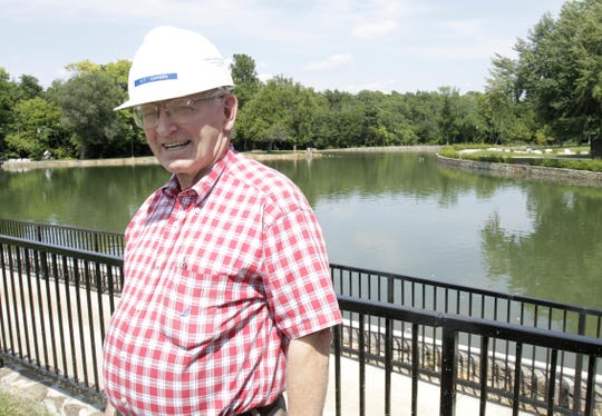 In this 2013 file photo, Kit Carson poses at Doling Park, where his construction company had completed renovations. Carson died this week at age 75.