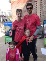 Rocky and Breanna Valentine with daughters Lily and Lyla (in a cape) participating in the American Health Association's Heart Walk 2018.