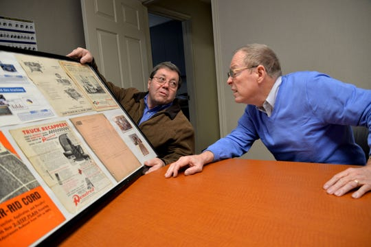 From left to right: Tommy and Terry Westhafer look at old photos and pamphlets from Central Tire in Verona. The tire company has been around for 74 years, owned by the Westhafer family. The tire shop will be switching ownership Feb. 18, 2019.