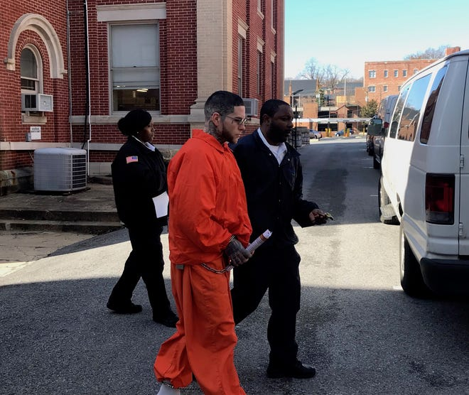 Eric D. Poe Jr., 34, is led away to a prison van Wednesday at the Augusta County Courthouse after being sentenced for a 2017 razor blade attack at the Augusta Correctional Center.