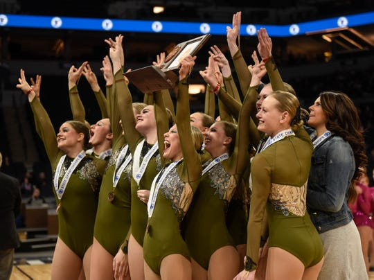 Sartell Dance Team members hold their third-place trophy during Minnesota State Dance Team Class 2A Jazz finals Friday, Feb. 16, 2018, at the Target Center in Minneapolis.