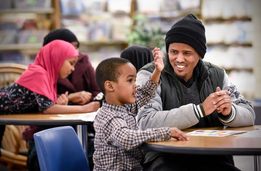 Parents and children work together to complete a learning exercise during an Empower Learning program Tuesday, Feb. 12, at Discovery Community School in Waite Park.