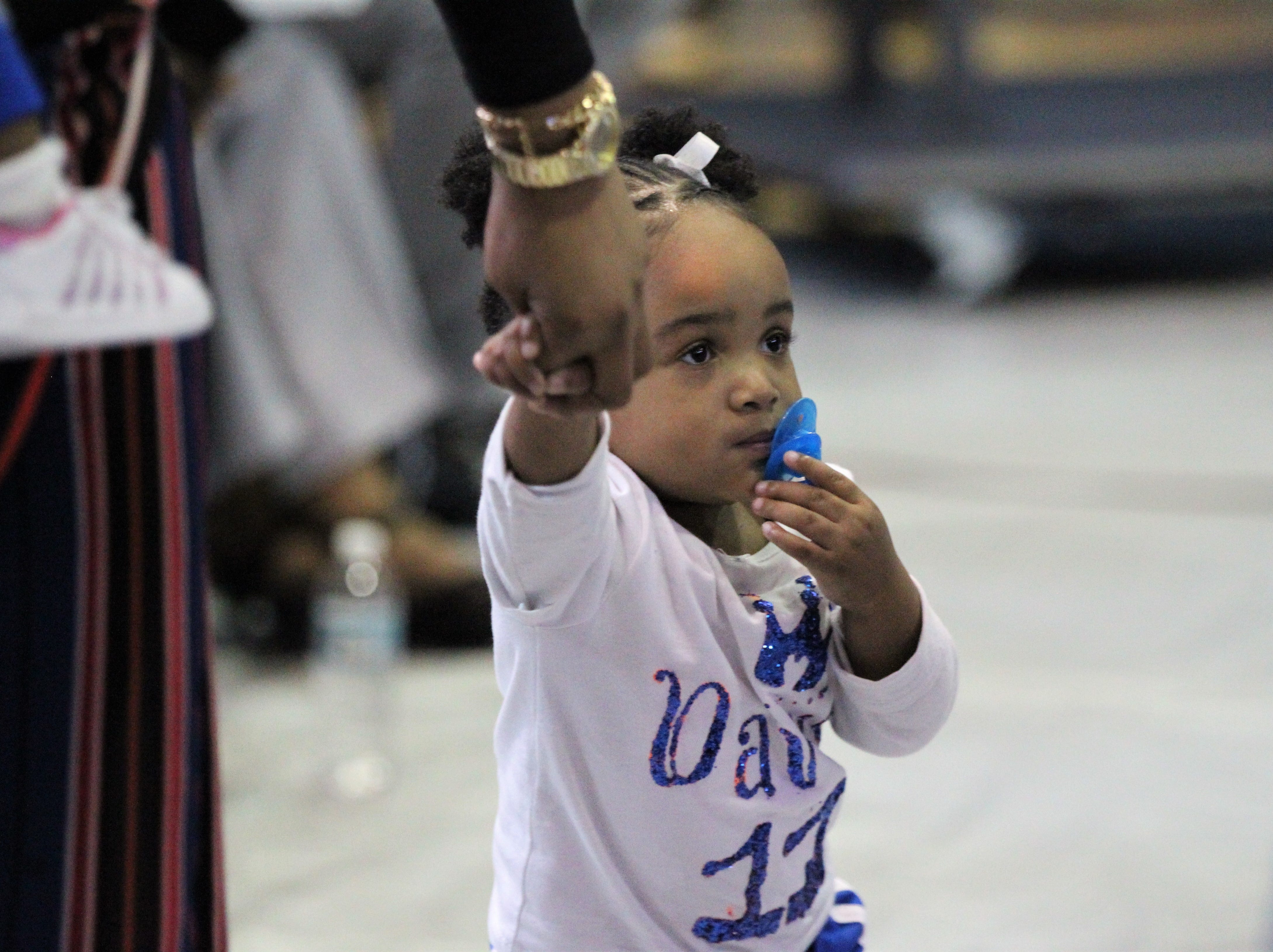 Jefferson County receiver Da'Shon Davis' nearly 2-year-old daughter De'ari during Jefferson County's signing day ceremony on Feb. 13, 2019. Davis signed with Tennessee State.
