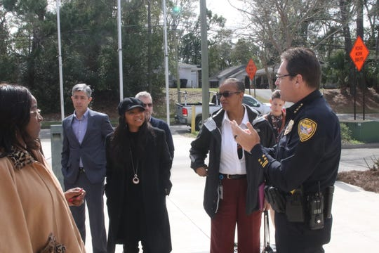 Tallahassee Police Chief Michael DeLeo greets city officials, Commissioners Dianne Williams-Cox at left, City Manager Reese Goad in grey and Elaine Bryant in garnet, before a tour of TPD's headquarters.