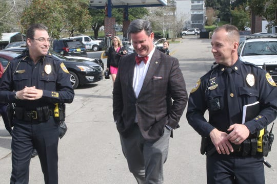 Mayor John Dailey, center, walks with Police Chief Michael DeLeo, right, and Maj. Sam Gereg during a tour of TPD's facilities.