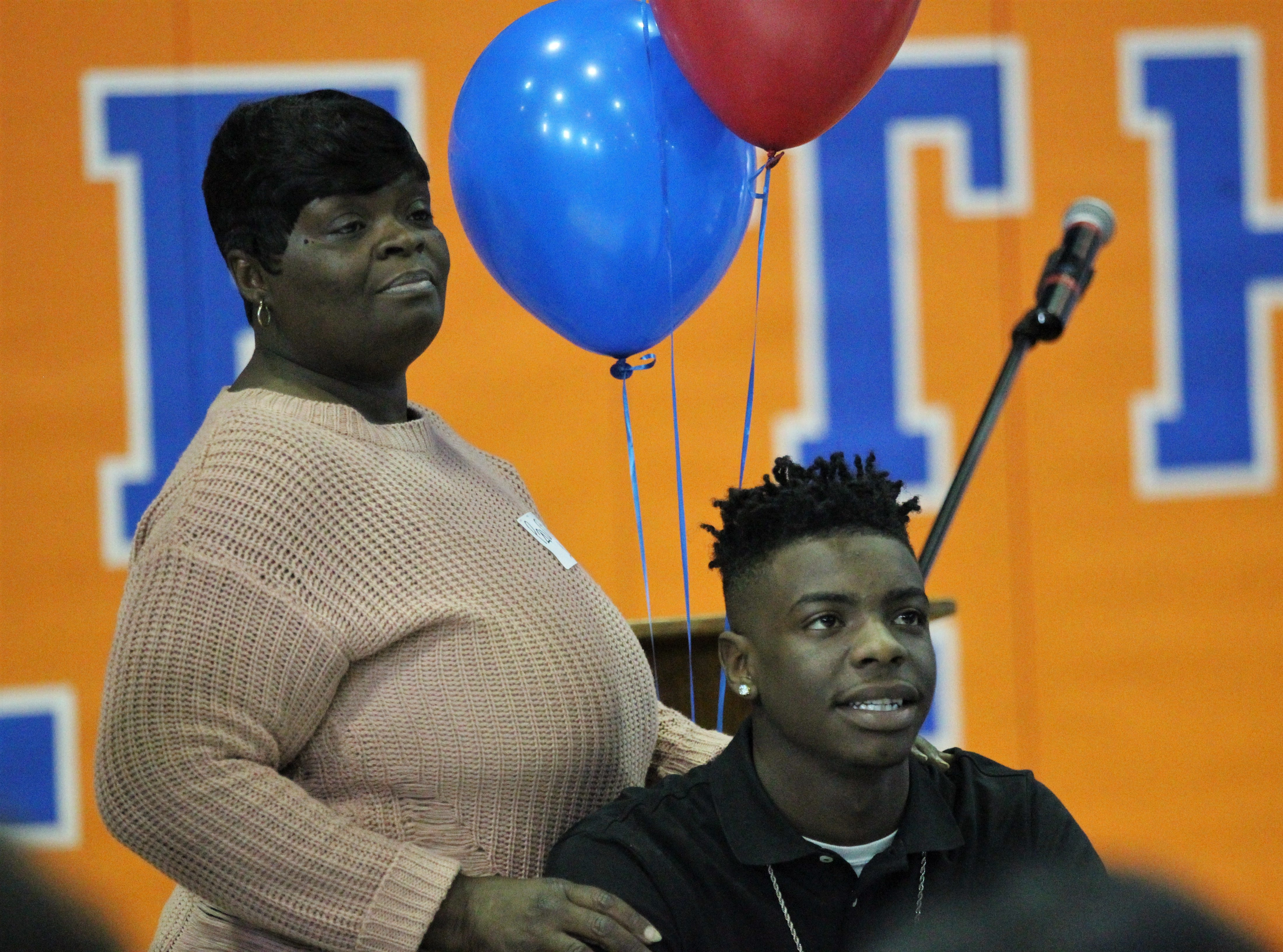 Jefferson County receiver Javion Patrick waits with his mother Liwonda Patrick before Jefferson County's signing day ceremony on Feb. 13, 2019.