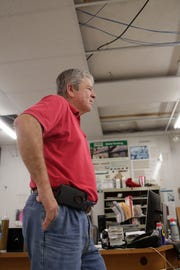 Jim Waldorff, one of the owners of the Ace Hardware store in Altha, Fla., talks about damage that was done to his roof by Hurricane Michael and how he was just able to get it to the point where it was not leaking anymore, Tuesday Feb. 12, 2019.