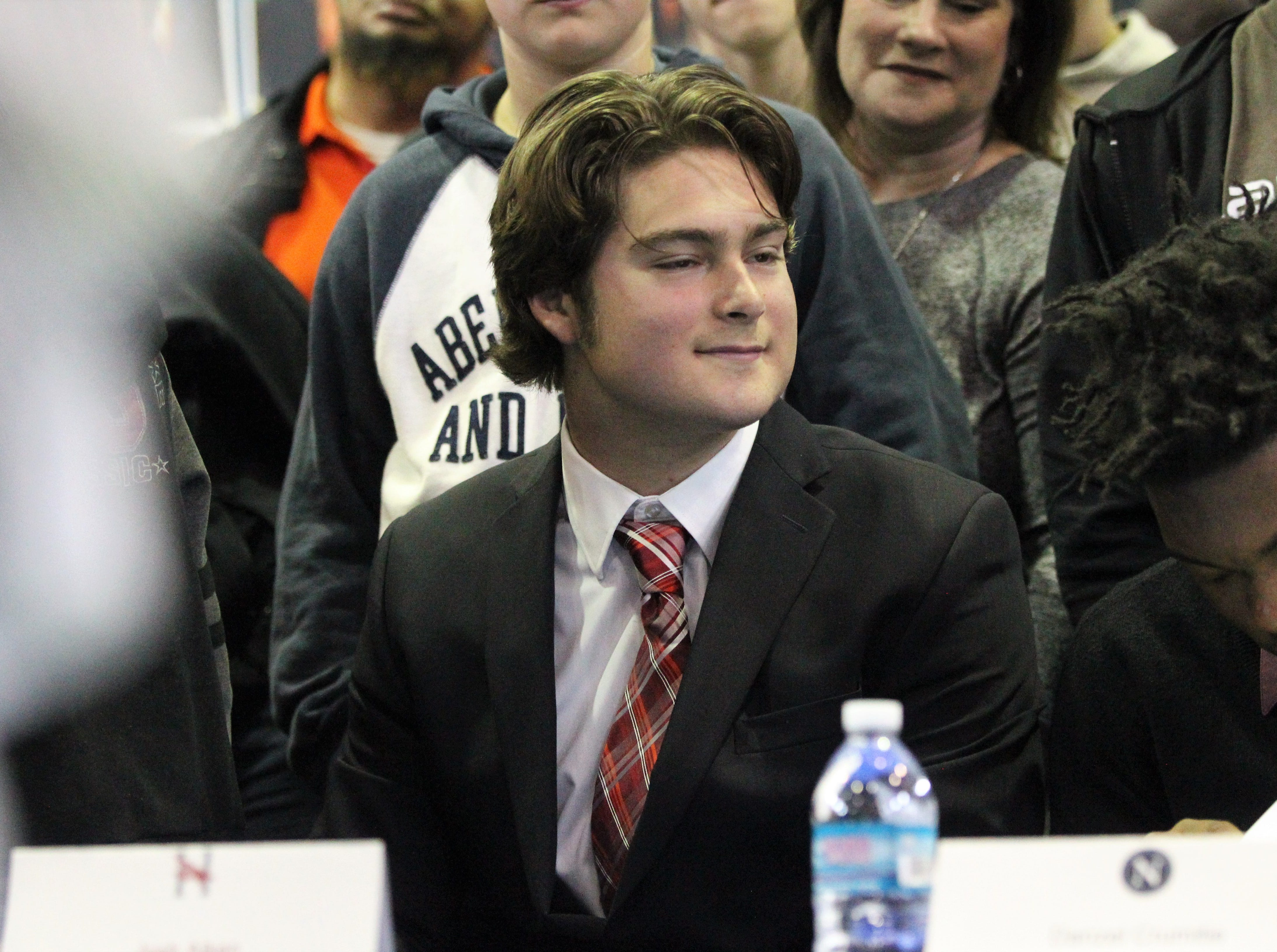 Jefferson County quarterback Josh Aiken, who signed with Huntingdon College, smiles during Jefferson County's signing day ceremony on Feb. 13, 2019.