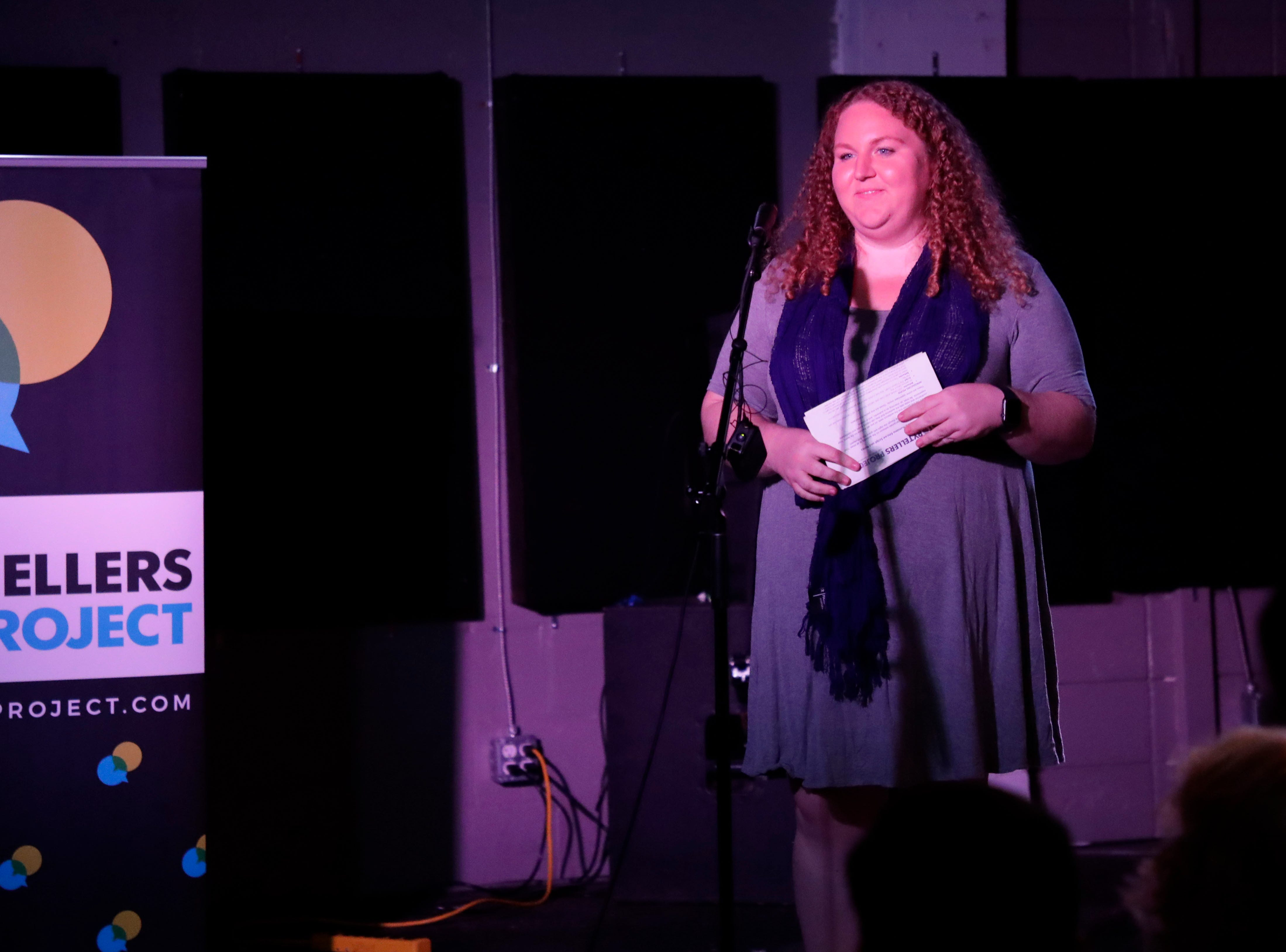 Ashley White, K-12 reporter for the Tallahassee Democrat, gives an introduction of what to expect at Story Tellers, Tuesday Feb. 12, 2019.