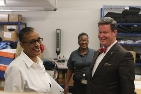 City Commissioner Elaine Bryant, left, and Mayor John Dailey enjoy a laugh during a tour of the Tallahassee Police Department Headquarters.
