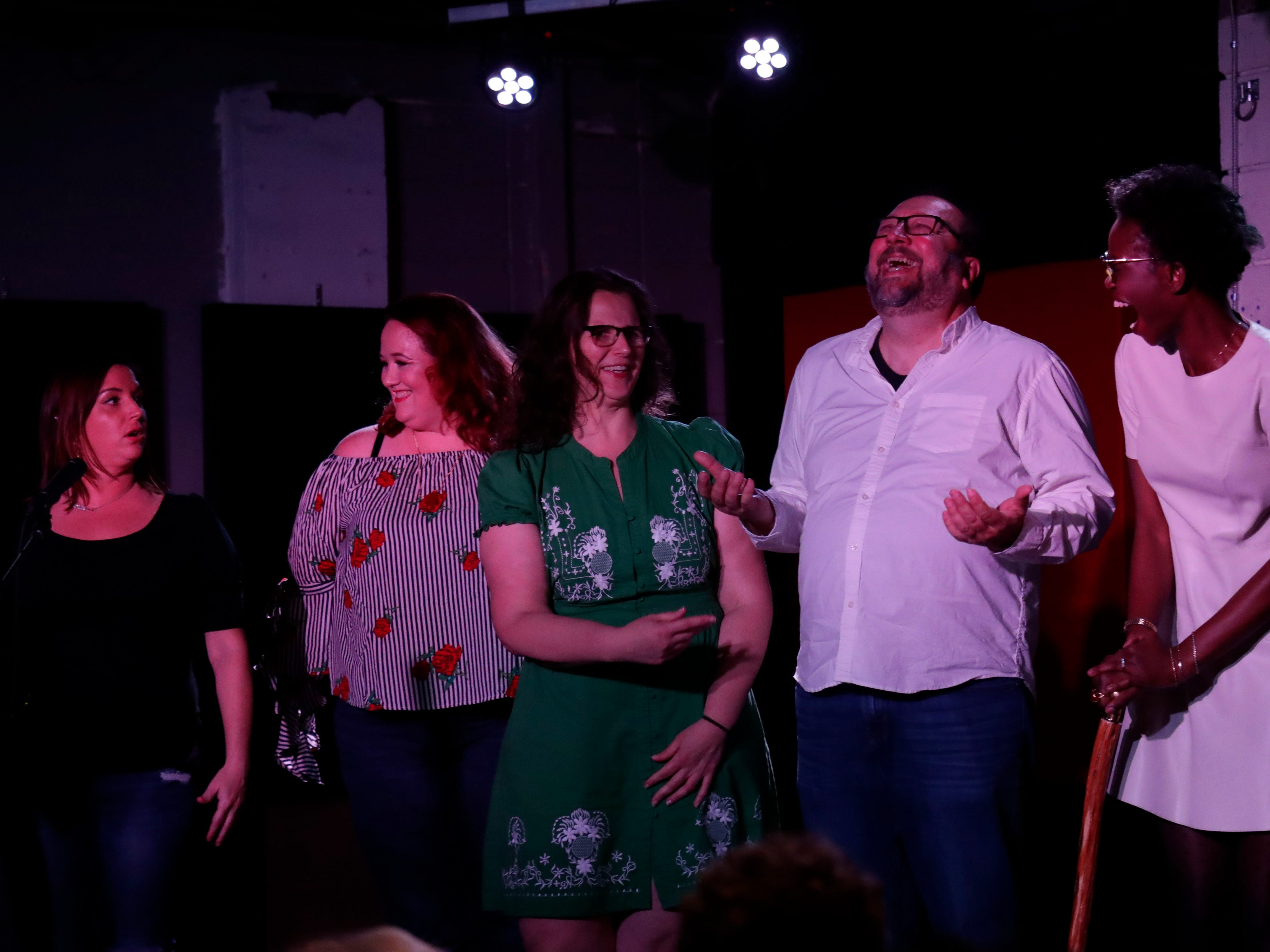Chryssy Moor, left, Mandy Bianchi, Holly Thompson, Jeff Schweers, and Ashley Smith, the five tellers from the Story Teller's Project at the Wilbury, Tuesday Feb. 12, 2019 take the stage for a final bow after sharing their stories.