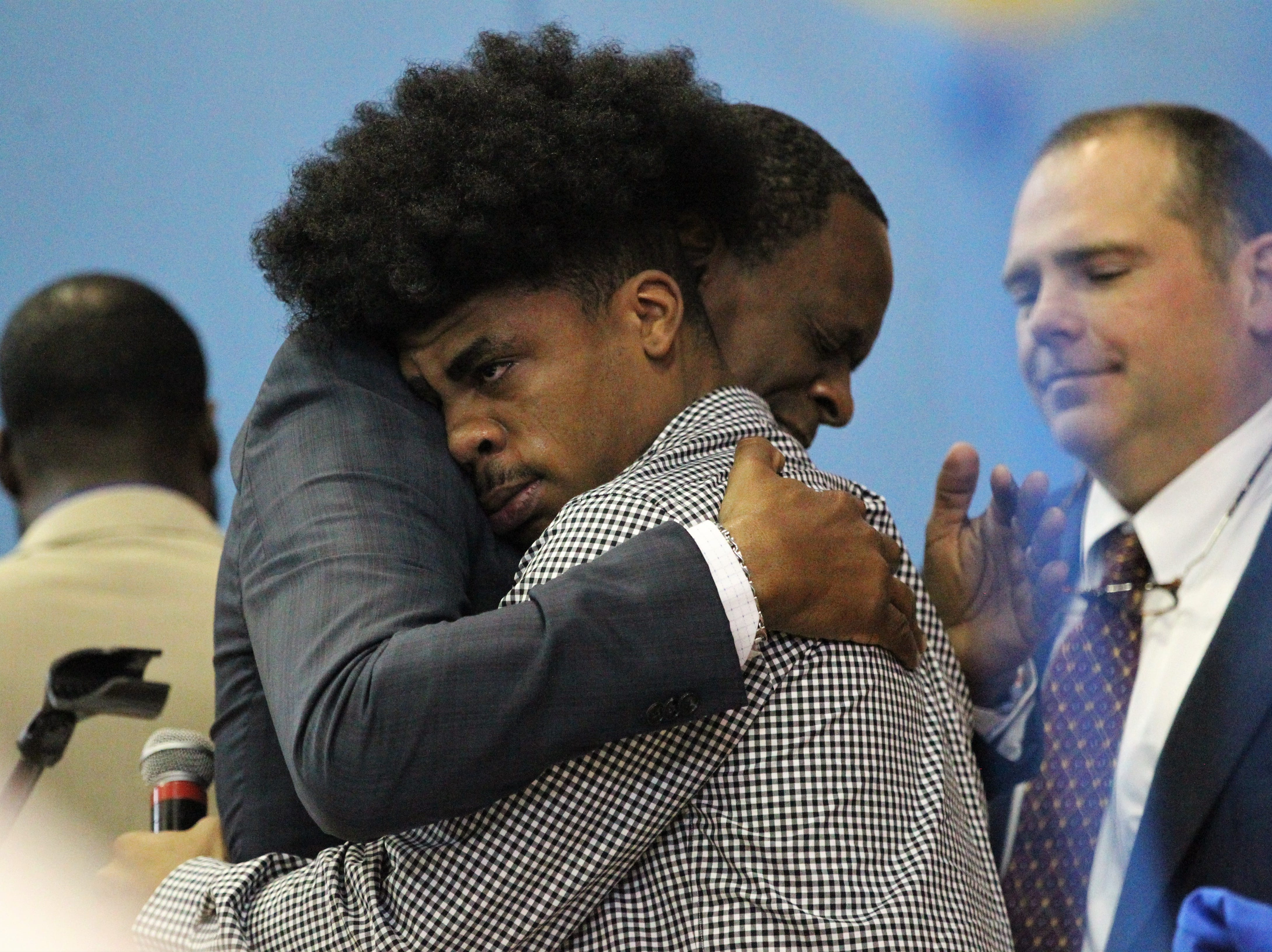 Jefferson County receiver Armon Williams gets a hug from Rev. Greg James during Jefferson County's signing day ceremony on Feb. 13, 2019. Williams, who signed with Fullerton College, got emotional talking about how his coach Leroy Smith, James, and state attorney Jack Campbell helped him get his life turned around after he committed a crime and spent time in jail.