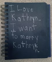The note Kyle Frost wrote about his classmate -- and future wife -- Kathryn.