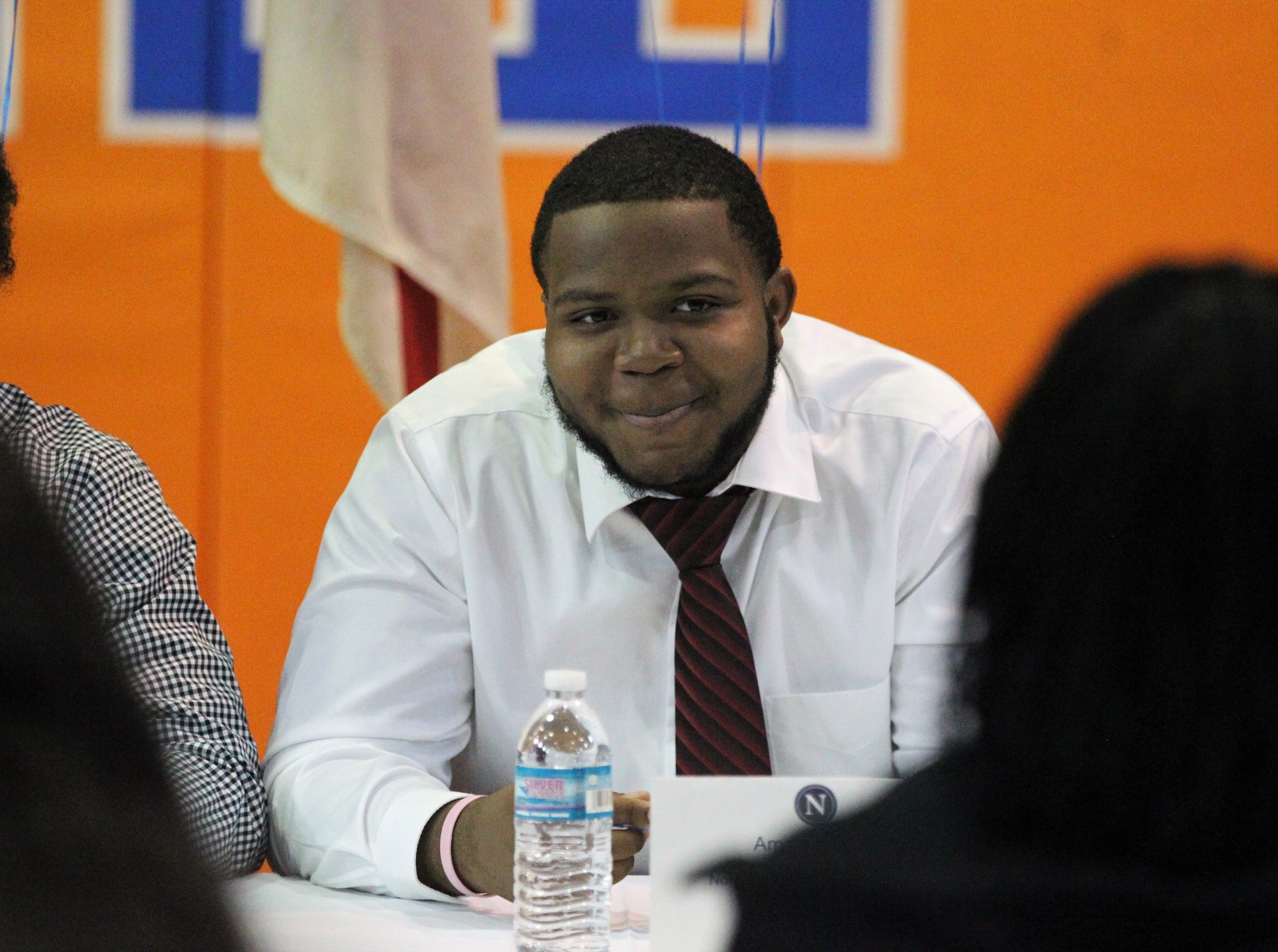 Jefferson County lineman Amantez Ford waits to sign with Northland College during Jefferson County's signing day ceremony on Feb. 13, 2019.