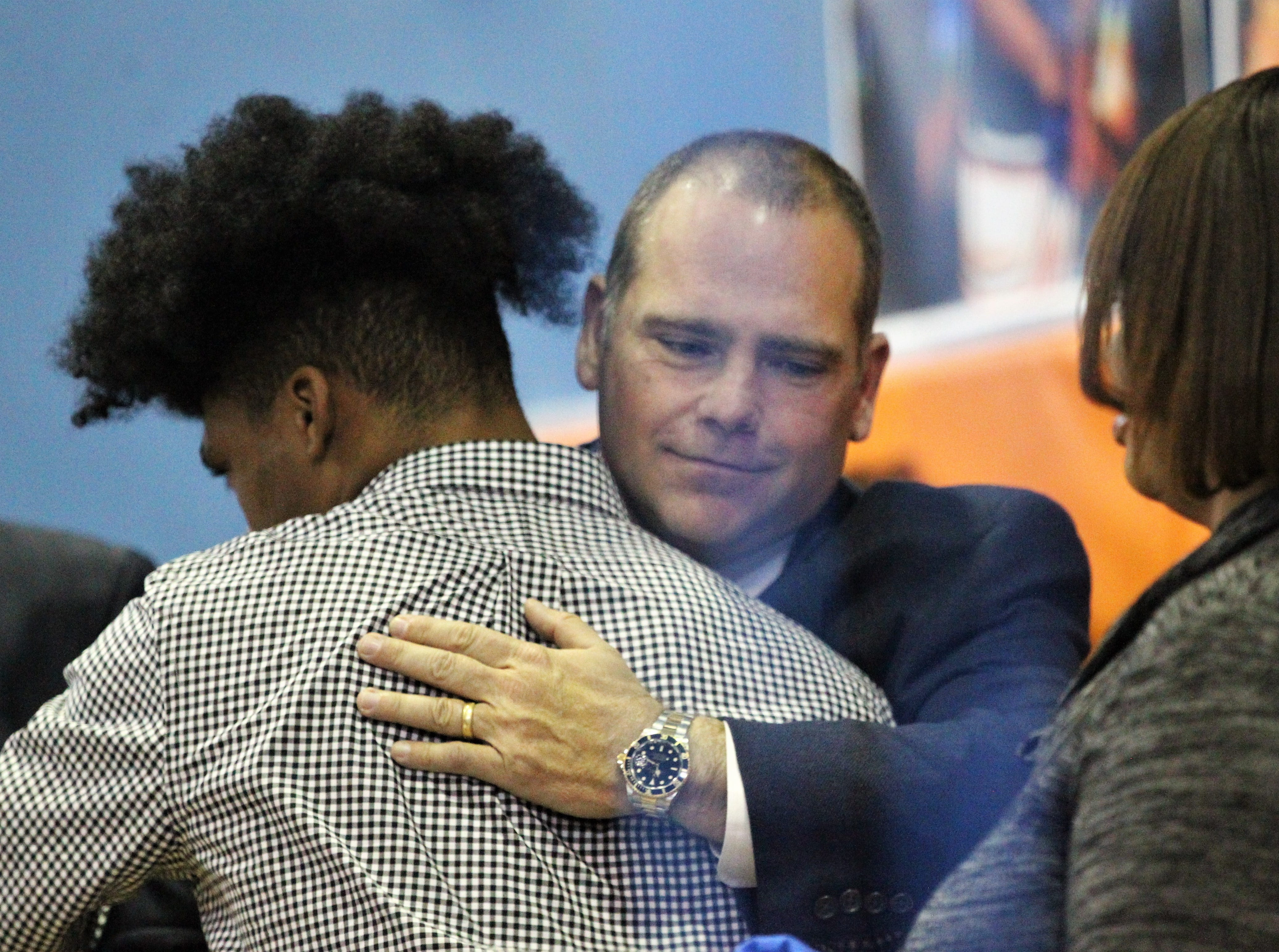 Jefferson County receiver Armon Williams gets a hug from state attorney Jack Campbell during Jefferson County's signing day ceremony on Feb. 13, 2019. Williams, who signed with Fullerton College, got emotional talking about how his coach Leroy Smith, Rev. Greg James, and Campbell helped him get his life turned around after he committed a crime and spent time in jail.