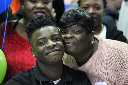 Jefferson County receiver Javion Patrick and mother Liwonda Patrick smile for a photo during Jefferson County's signing day ceremony on Feb. 13, 2019.
