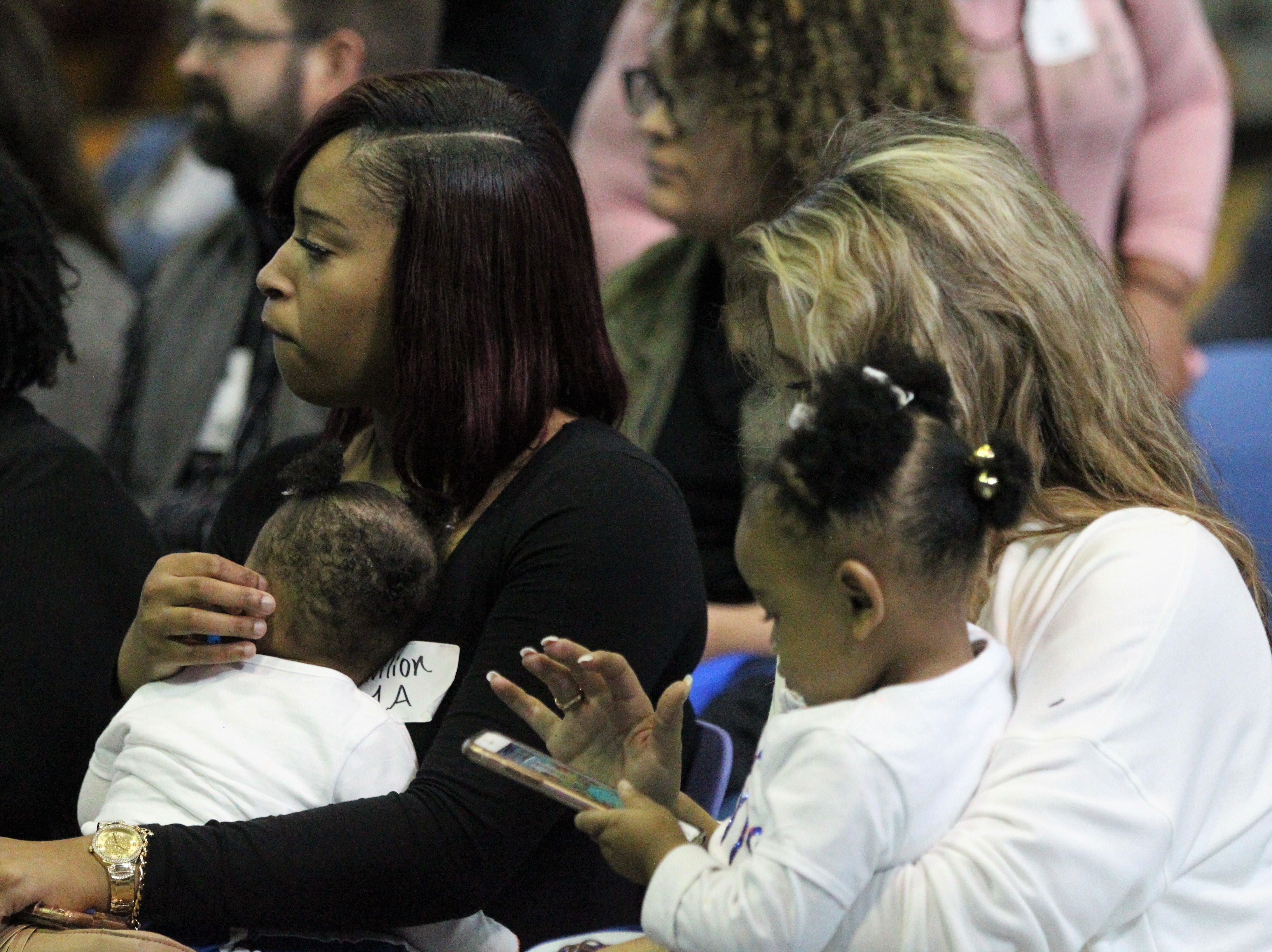 Jefferson County receiver Da'Shon Davis' daughters Desire (9 months) and De'ari (almost 2) wait with their mother during Jefferson County's signing day ceremony on Feb. 13, 2019. Davis signed with Tennessee State.