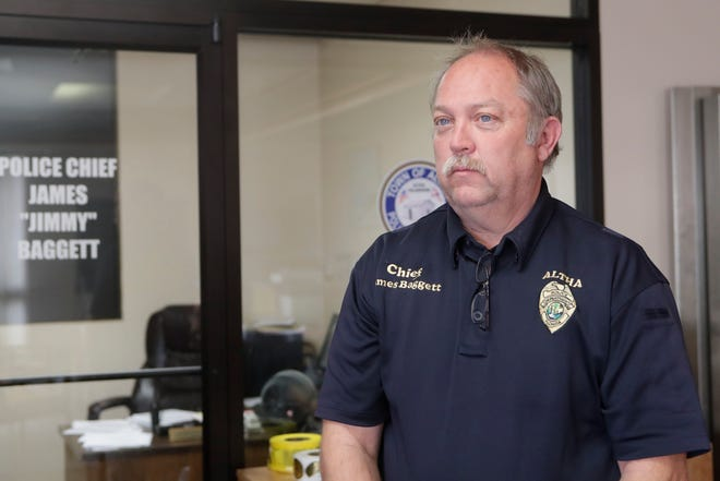 Police Chief James Baggett stands in the Altha Town Hall, Tuesday Feb. 12, 2019. Baggett lists all of the duties he has taken on since the mayor quit, including being the school crossing guard and being the town's garbage man.