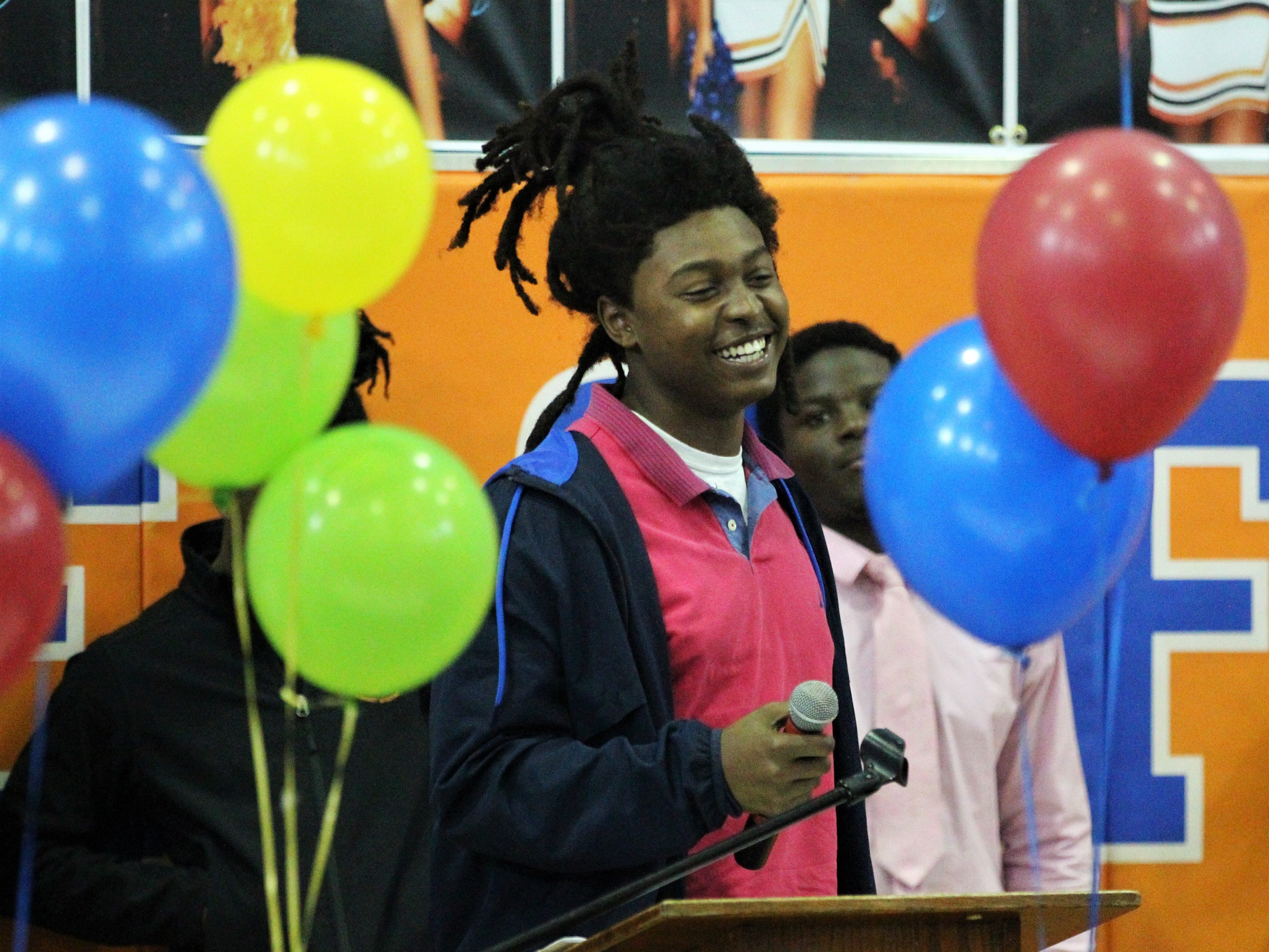 Jefferson County defensive lineman Kimiri Thomas laughs while speaking during Jefferson County's signing day ceremony on Feb. 13, 2019. Thomas signed with Mesabi Range College.