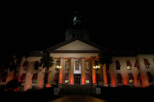The Florida Historic Capitol Museum is lit with orange lights Tuesday, Feb. 12, 2019, in honor of the victims of the Feb. 14, 2018 Marjory Stoneman Douglas High School shooting.