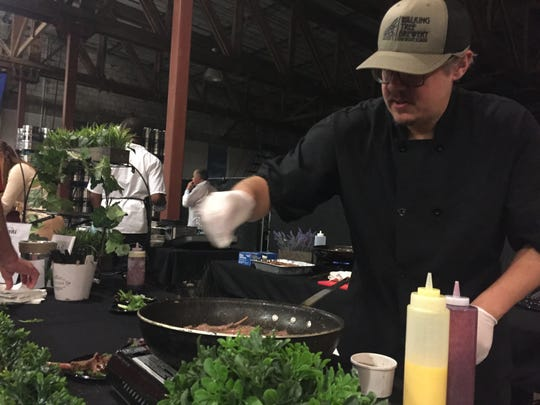 Mike Beasley of Wild Time Catering stays busy Feb. 8, 2019, preparing herb-crusted lamb chops with blackberry lime coulis at Sunrise Rotary's Florida Craft Brew & Wingfest VIP party at Walking Tree Brewery in Vero Beach. It was named the top dish at the event.
