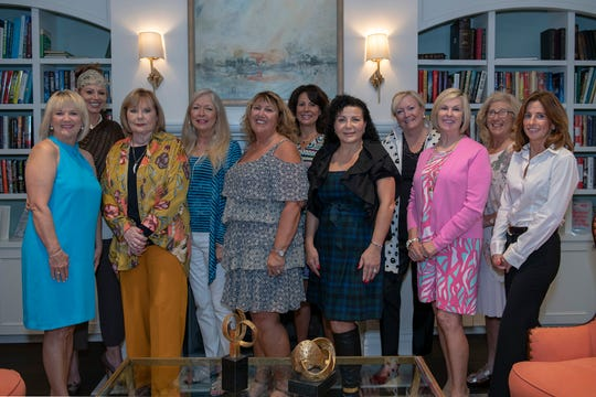 Judy Matthews, left, Robin Remington, Donna Forcella, Susan Ash, Lorraine Popky, Debra Gaudreau, Catrina Genero, Pam Graham, Margie Barr, Suki Blustein and Leslie White at the Hearts of Hope Luncheon at Piper's Landing Yacht and Country Club in Palm City.