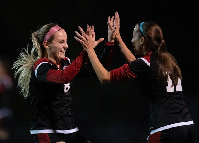 Vero Beach's Kate Hassell (left) celebrates after scoring a goal with teammate Lauren Barkett in the first half of their regional championship game against Boca Raton at Vero Beach High School's Citrus Bowl on Tuesday, Feb. 12, 2019, in Vero Beach