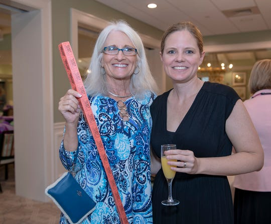 Michele Bragg, left, and Danielle McMullin hoping to win one of the valuable raffle baskets at the Hearts of Hope Luncheon at Piper's Landing Yacht and Country Club in Palm City.