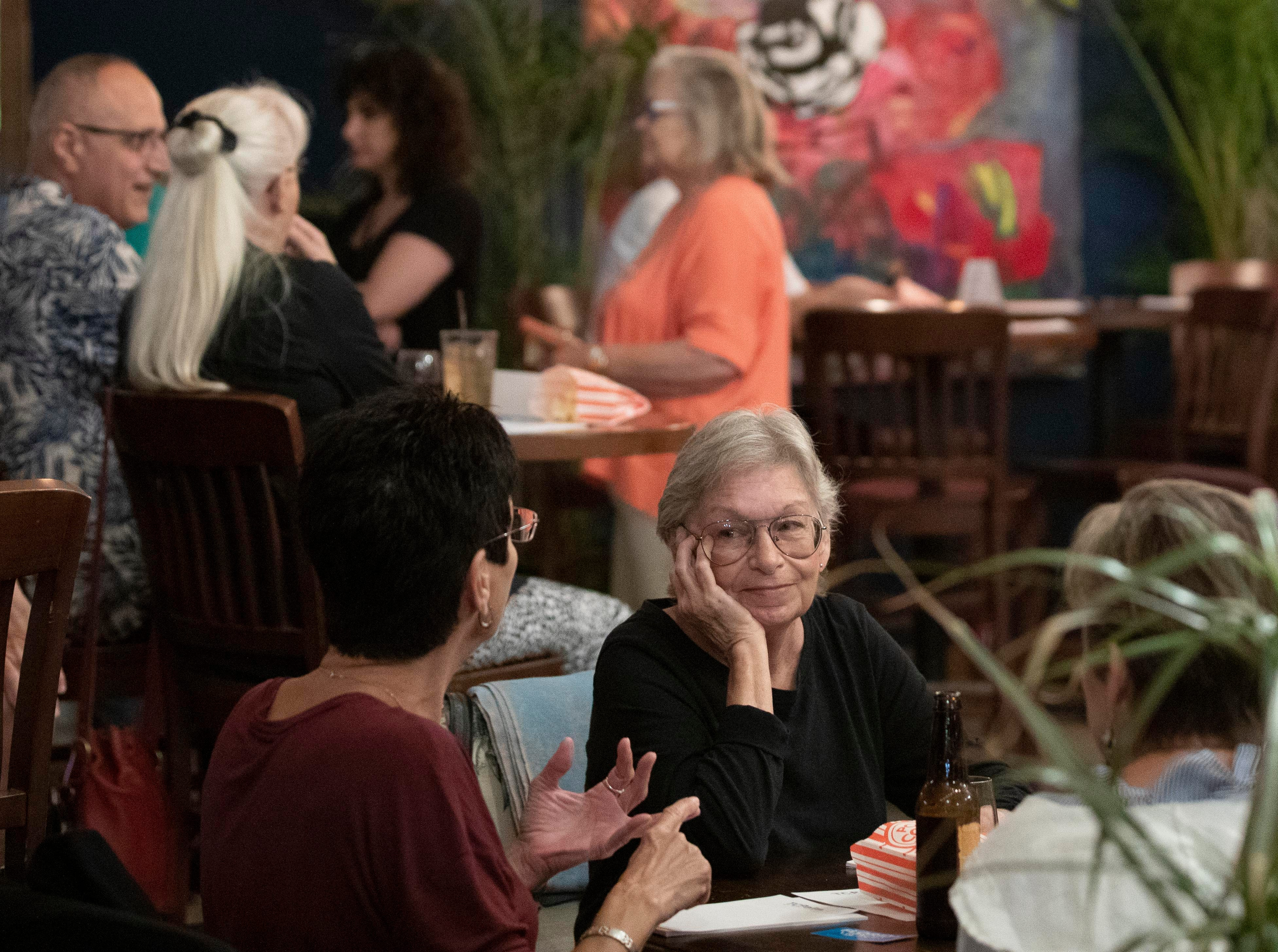 """TCPalm held their inaugural Documentary & Drinks event on Tuesday, Feb. 12, 2019, at Ground Floor Farm in Stuart. They showed the 24-minute film, """"A State in Transition,"""" which grew out of TCPalm's Florida Voices project. Visuals journalist Leah Voss and opinion/audience engagement editor Eve Samples interviewed 22 Floridians from across the state about what's important to them during this important time in Florida's history. The watch party included time for questions and community conversation."""