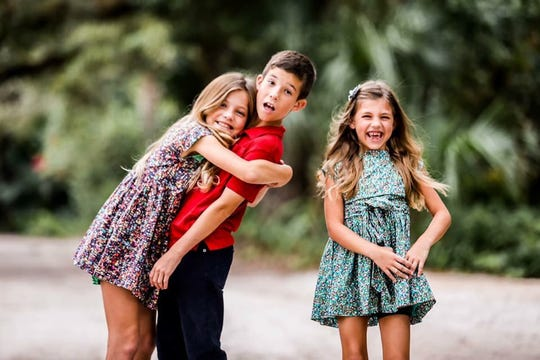 Palmer is in full remission and is back to clowning around with siblings Chandon, 11, and Saylor, 7.