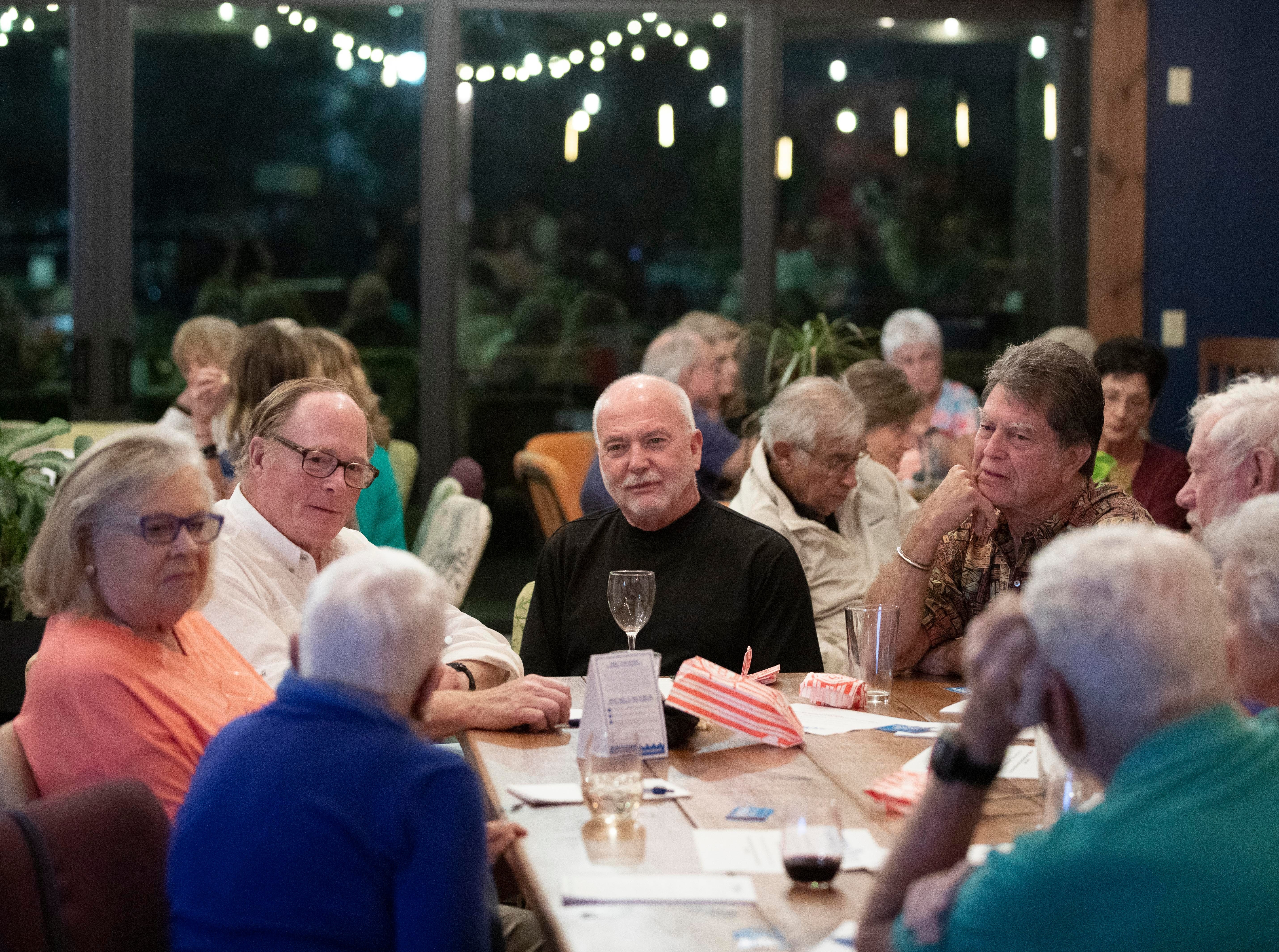 """""""It's greed that destroys the environment and when Florida loses its environment, it loses its economy,"""" said Bill Martz (center), of Port St. Lucie, who discusses water quality during TCPalm's inaugural Documentary & Drinks event on Tuesday, Feb. 12, 2019, at Ground Floor Farm in Stuart. They showed the 24-minute film, """"A State in Transition,"""" which grew out of TCPalm's Florida Voices project. Visuals journalist Leah Voss and opinion/audience engagement editor Eve Samples interviewed 22 Floridians from across the state about the issues most important to them during this crucial time in Florida's history. The watch party included time for questions and community conversation."""