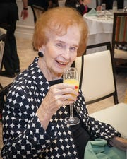 Elisabeth Lahti enjoys her complimentary mimosa at the Hearts of Hope Luncheon at Piper's Landing Yacht and Country Club in Palm City.
