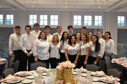 John Carroll High School Alpha Team members, a student ministry of seniors, volunteered at the 2019 John Carroll Gala on Jan. 26 at The Promenade on the River in Port St. Lucie.