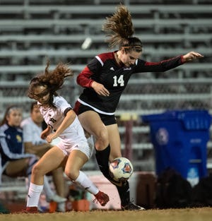 Vero Beach forward Emma Romans battles for a ball in the regional championship against Boca Raton on Tuesday, Feb. 12, 2019. Romans scored four goals in three regional games, including a hat trick against George Jenkins.