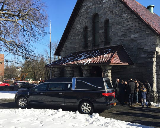 A hearse arrives at the funeral Mass for Valerie Reyes at St. Gabriel's Church, 120 Division St., New Rochelle, N.Y., on Wednesday, Feb. 13, 2019. Reyes's body was found by highway workers Feb. 5 inside a suitcase discarded near a Connecticut road. Javier Enrique Da Silva Rojas, 24, of Queens, N.Y., her ex-boyfriend, was held without bail Tuesday on a charge carrying a potential death penalty.
