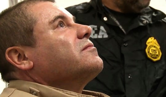 "In this Jan. 19, 2017, photo provided by the U.S. Drug Enforcement Administration, Mexican drug kingpin Joaquin ""El Chapo"" Guzman arrives at Long Island MacArthur Airport in Ronkonkoma, N.Y., after being extradited to the United States to face drug-trafficking charges. Guzman, was convicted Tuesday, Feb. 12, 2019, of running an industrial-scale smuggling operation after a three-month trial packed with Hollywood-style tales of grisly killings, political payoffs, cocaine hidden in jalapeño cans, jewel-encrusted guns and a naked escape with his mistress through a tunnel."